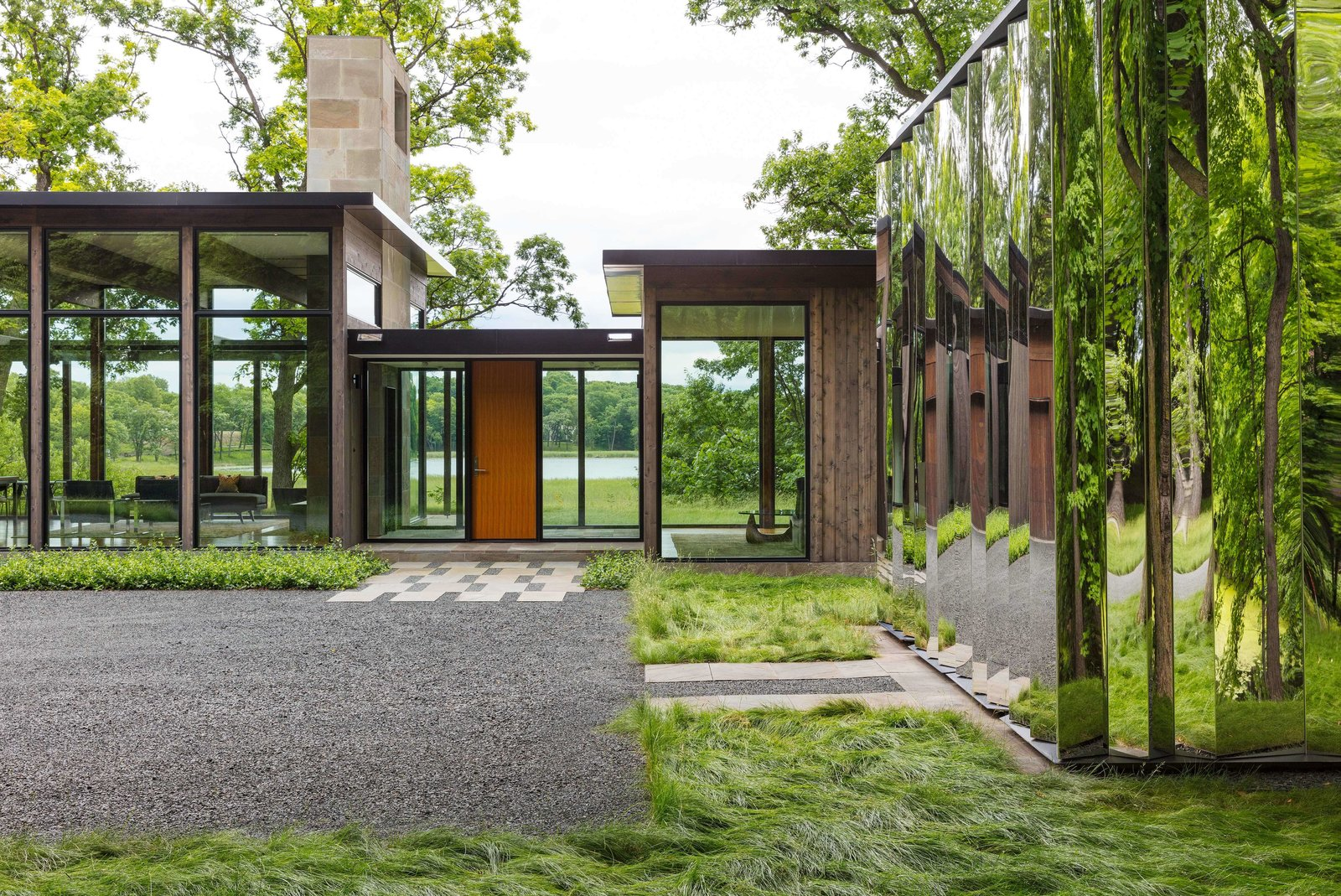 This glass house and shiny shed merge with nature in for Building a house in minnesota