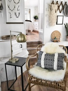 A sheepskin rug, a weave hanging on the wall, and vibrant fabrics add much personality to the newly renovated mobile home.