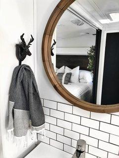 A chrome-plated IKEA Brogrund bath faucet with strainer.