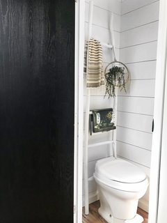 The walls of the bathroom were also painted white.