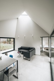 This Forest Retreat Is a Modern Take on the Traditional Estonian Hut - Photo 9 of 12 - Fully glazed walls on two sides and a triangular skylight allow light to permeate the living areas.