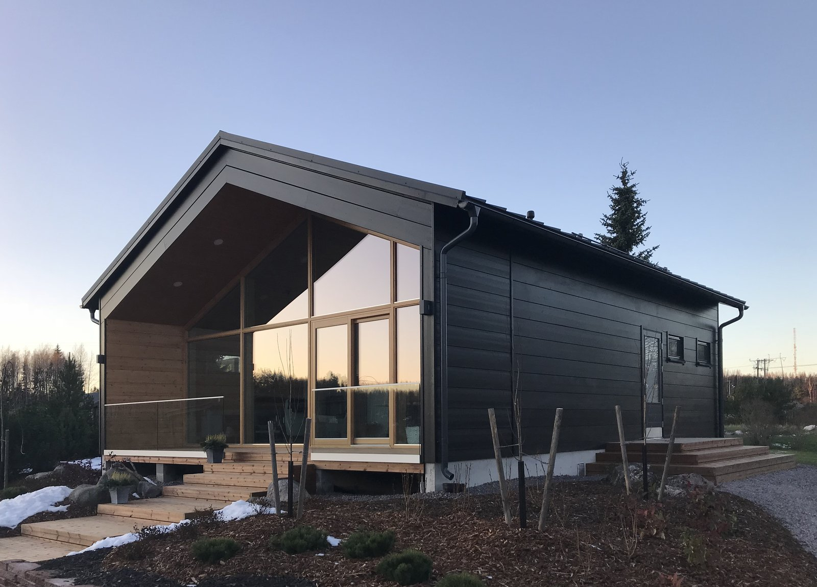 Vista cabin exterior with black painted wood and glass exterior.