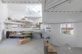 13 Spiraling Platforms Increase Space and Connection in This One-Room Home - Photo 4 of 13 - A space of 2.3 feet between the platforms allow the floor surfaces to double up as shelves, tables, or seating.