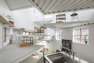 13 Spiraling Platforms Increase Space and Connection in This One-Room Home - Photo 8 of 13 - The underside of the corrugated metal platform floors are left exposed.