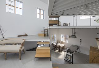 13 Spiraling Platforms Increase Space and Connection in This One-Room Home - Photo 10 of 13 - The living area at the heart of the house ascends up to the bedroom and bathroom.