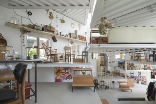 13 Spiraling Platforms Increase Space and Connection in This One-Room Home - Photo 2 of 13 - The different platforms give the family freedom to organize their furniture and possessions however they want.