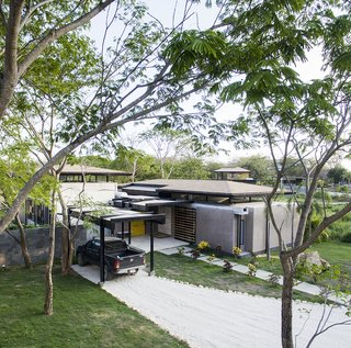 The home features a shaded parking lot near the entrance of the house.