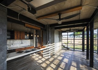 A Concrete Abode Becomes a Surfer's Paradise - Photo 15 of 23 - Another kitchen is located in the smallest of the three buildings.