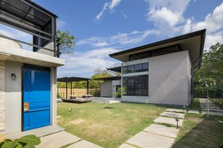 A Concrete Abode Becomes a Surfer's Paradise - Photo 13 of 23 - There are numerous garden spaces surrounding the buildings.