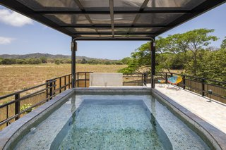 A plunge pool on the roof of the small building makes for a great place to rest and unwind.