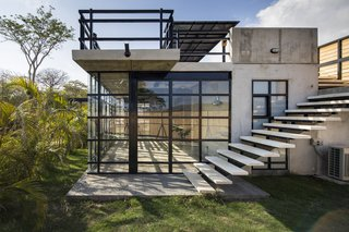 A Concrete Abode Becomes a Surfer's Paradise - Photo 14 of 23 - The windows are customized to control the light and air flow in different parts of the property.