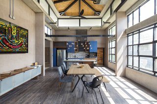 The dining and kitchen area encompass a bright and airy vibe.