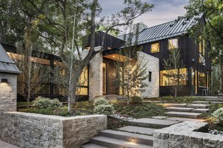 The home is composed of limestone masonry and structural steel accents.