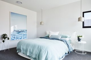 This light blue bedroom was inspired by the home's coastal location.