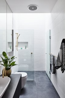 The bathroom is fitted with a clean and modern shower.