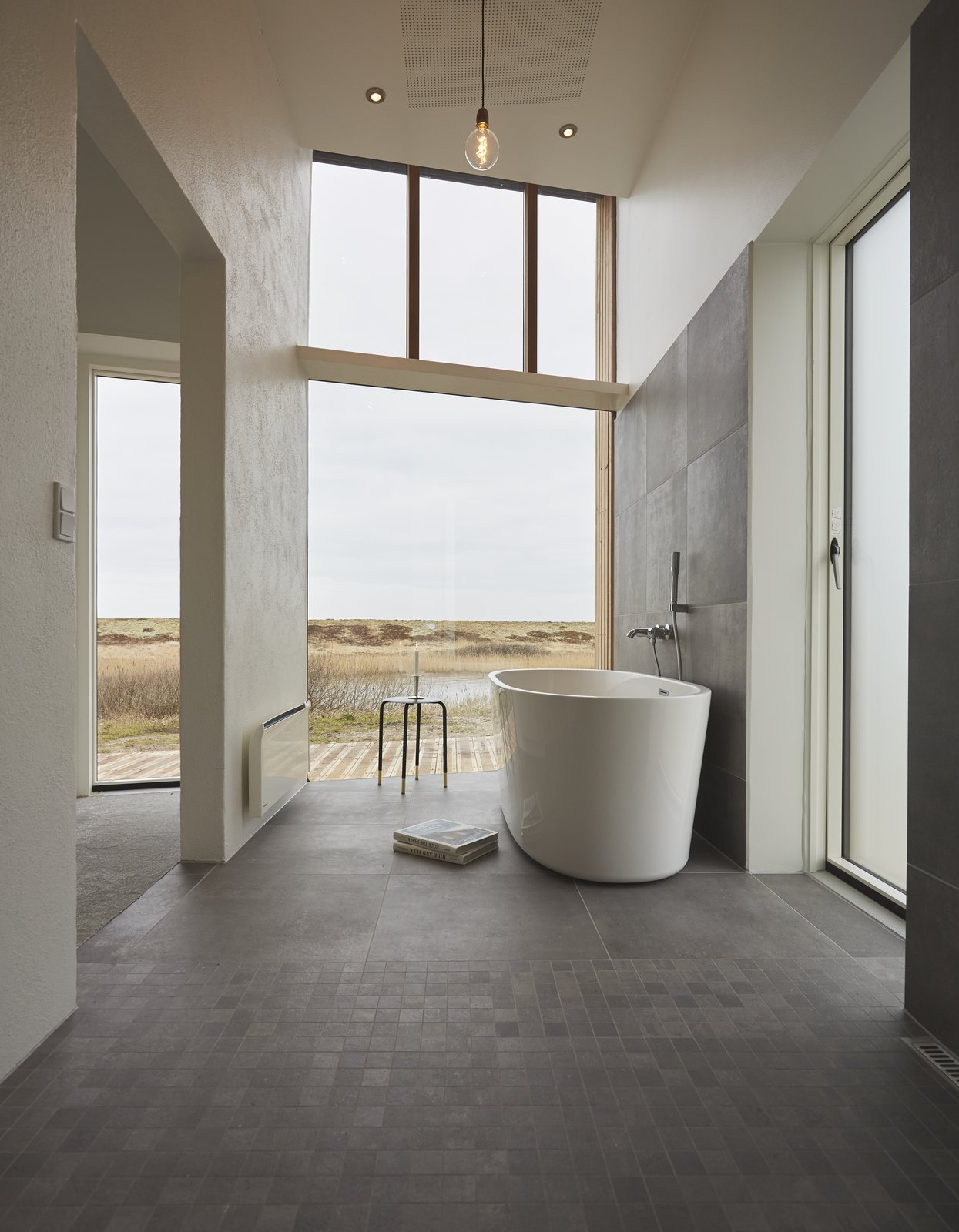 Bath Room, Slate Floor, Freestanding Tub, Pendant Lighting, Recessed Lighting, and Soaking Tub  Photo 4 of 40 in 40 Modern Bathtubs That Soak In the View from Rent This Danish A-Frame For Your Next Nordic Escape