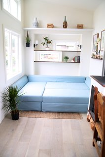The light blue sofa bed has been purchased from IKEA.