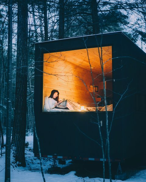 Each Getaway cabin has heating, a hot shower with bath products, an electric toilet, a mini-kitchen, and either one or two queen beds with fresh linens and pillows.