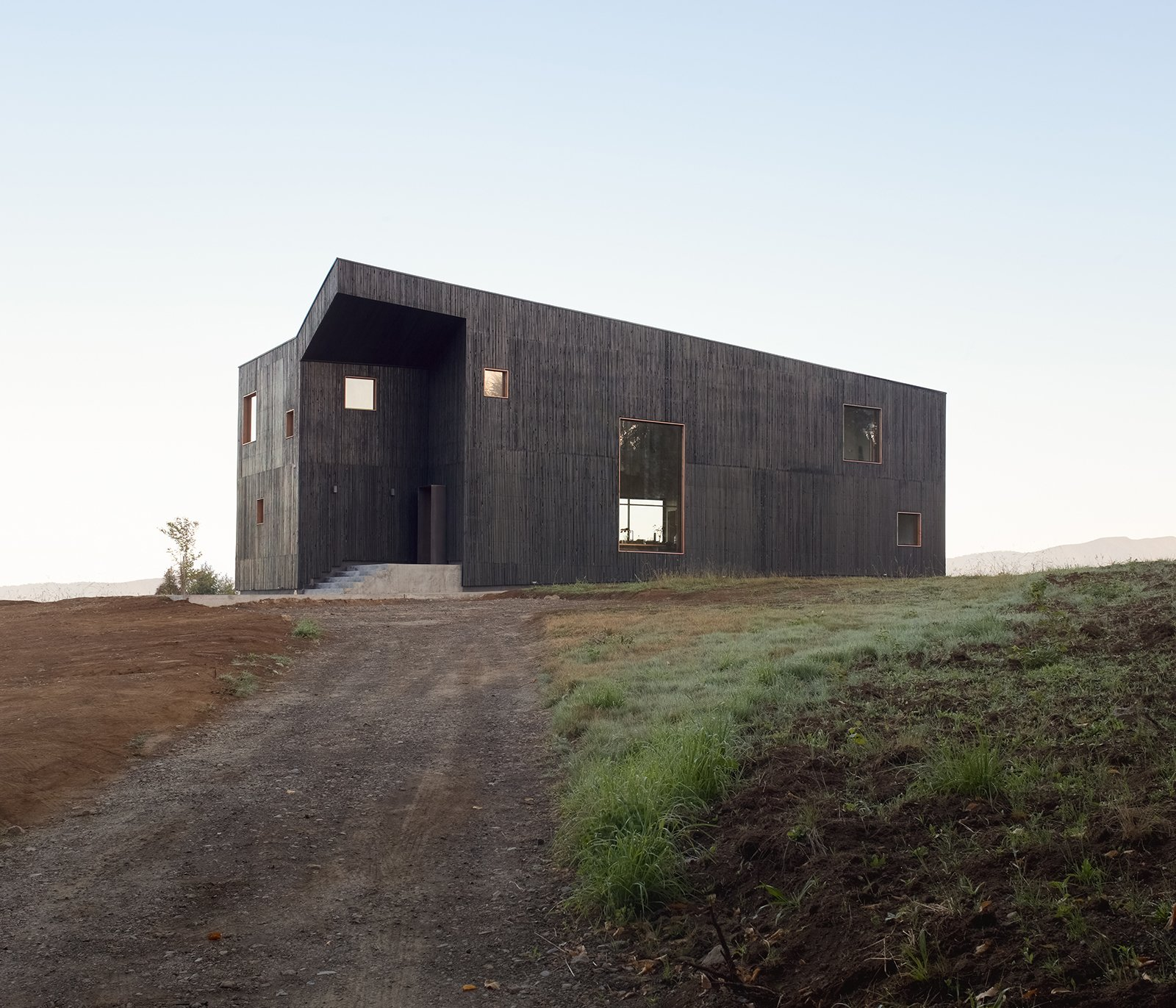 Exterior, House Building Type, and Wood Siding Material  Photos from A Black Timber Home in Chile Echoes Local Volcanic Stone