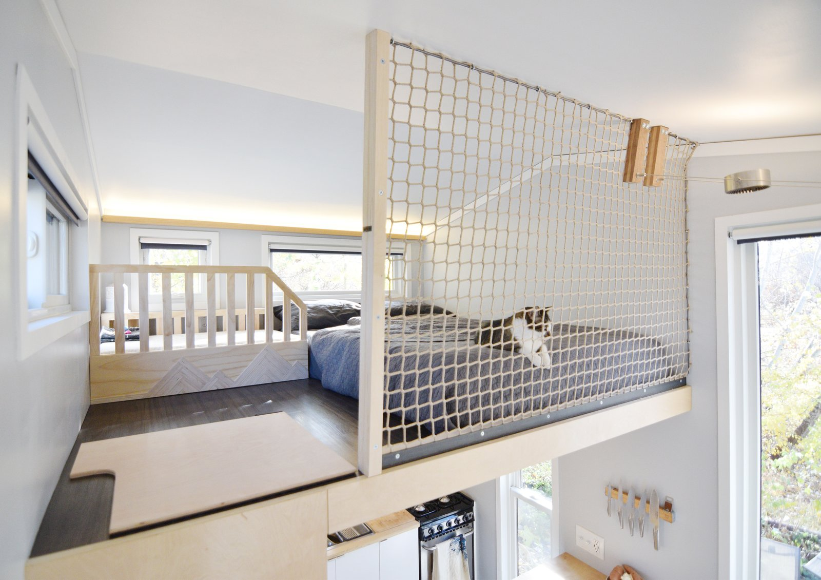 when it came time to add a safety barrier for their daughter Aubrin, they opted to install tight netting so the two areas did not need to be visually separated.