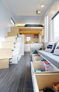 Storage is cleverly located throughout the house, including under the bench in the living room.