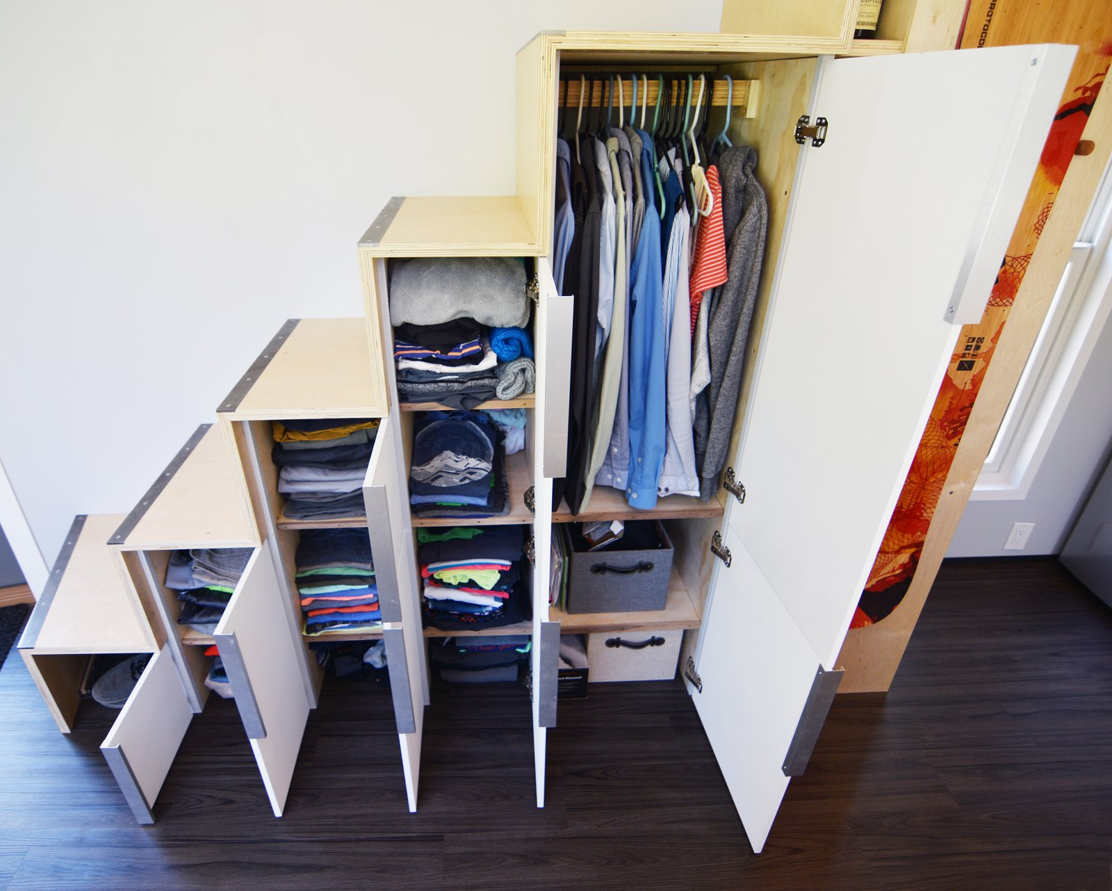 Plenty of storage spaces were created under the stairs.