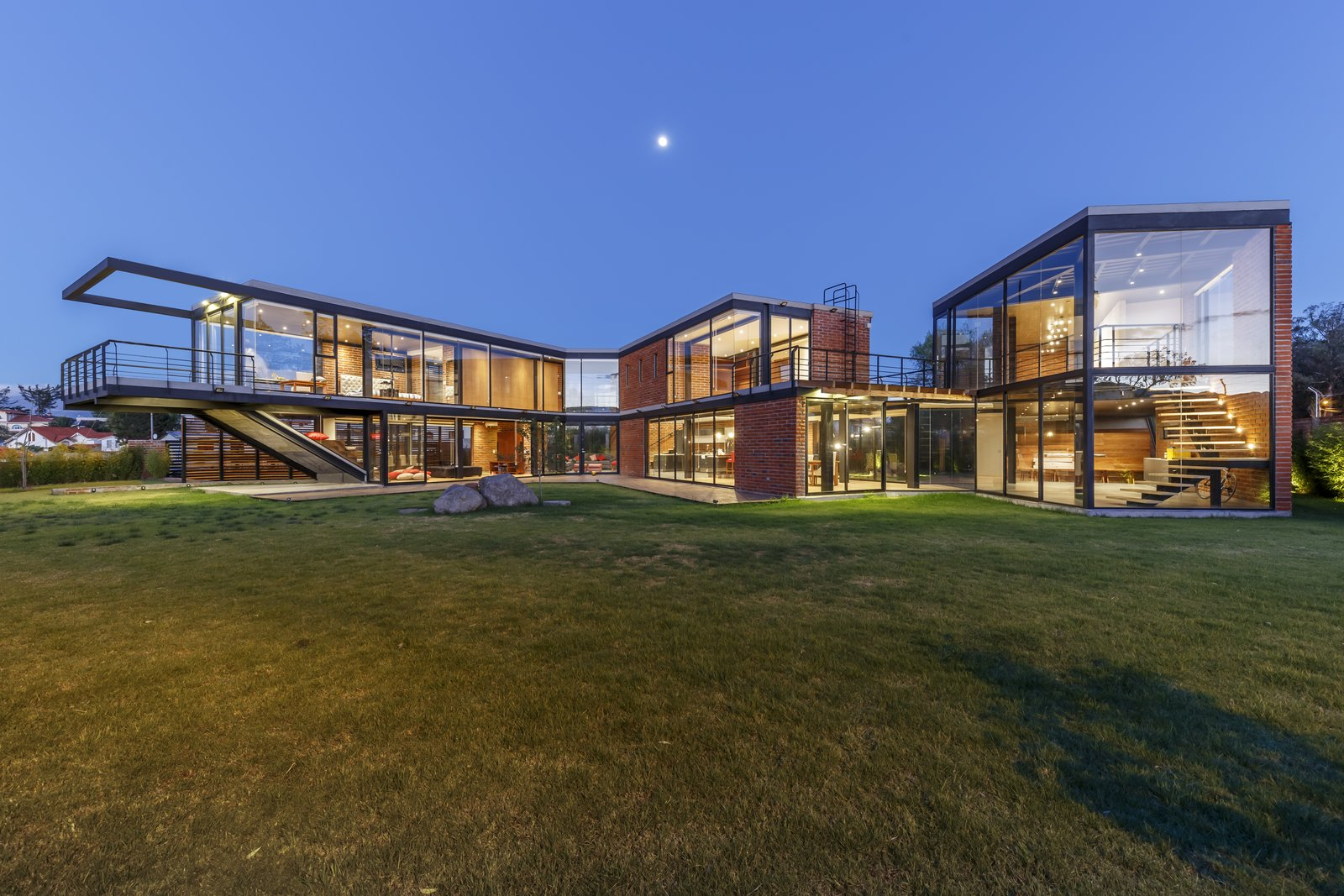 Exterior, Brick, Glass, Metal, Flat, House, and Wood  Best Exterior Glass Brick Wood Metal Photos from A Family Lives Harmoniously Together in This Captivating Multi-Generational Home