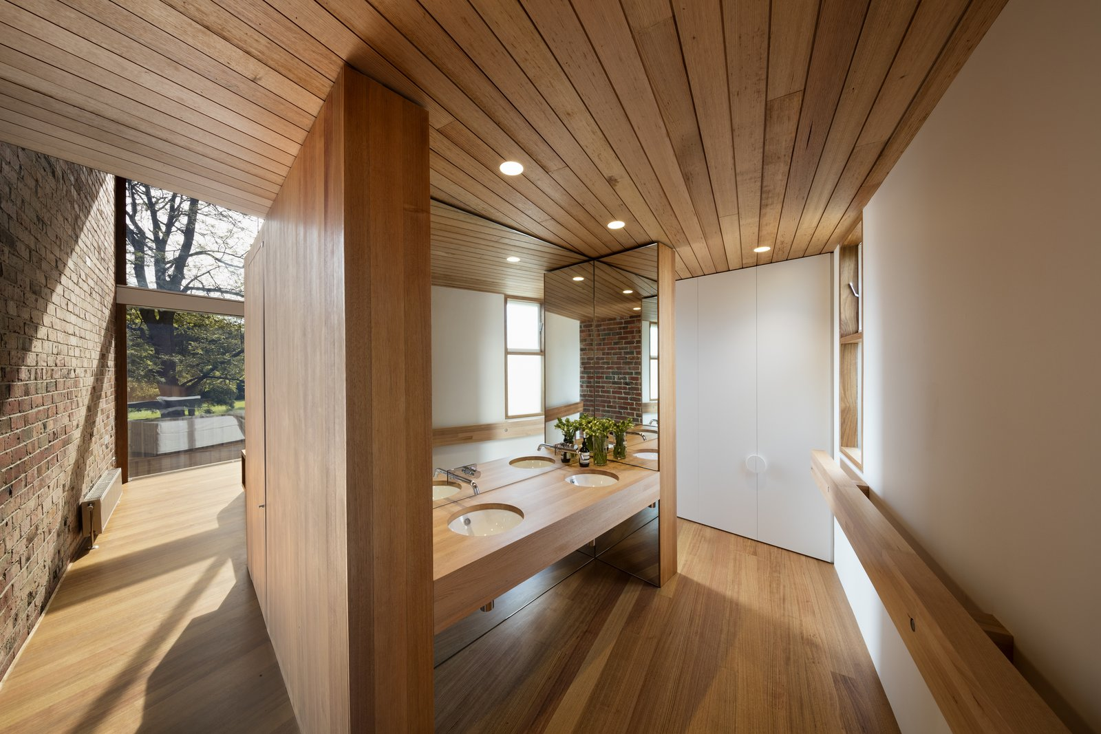 The private areas are separated, but visually connected to the new living area.