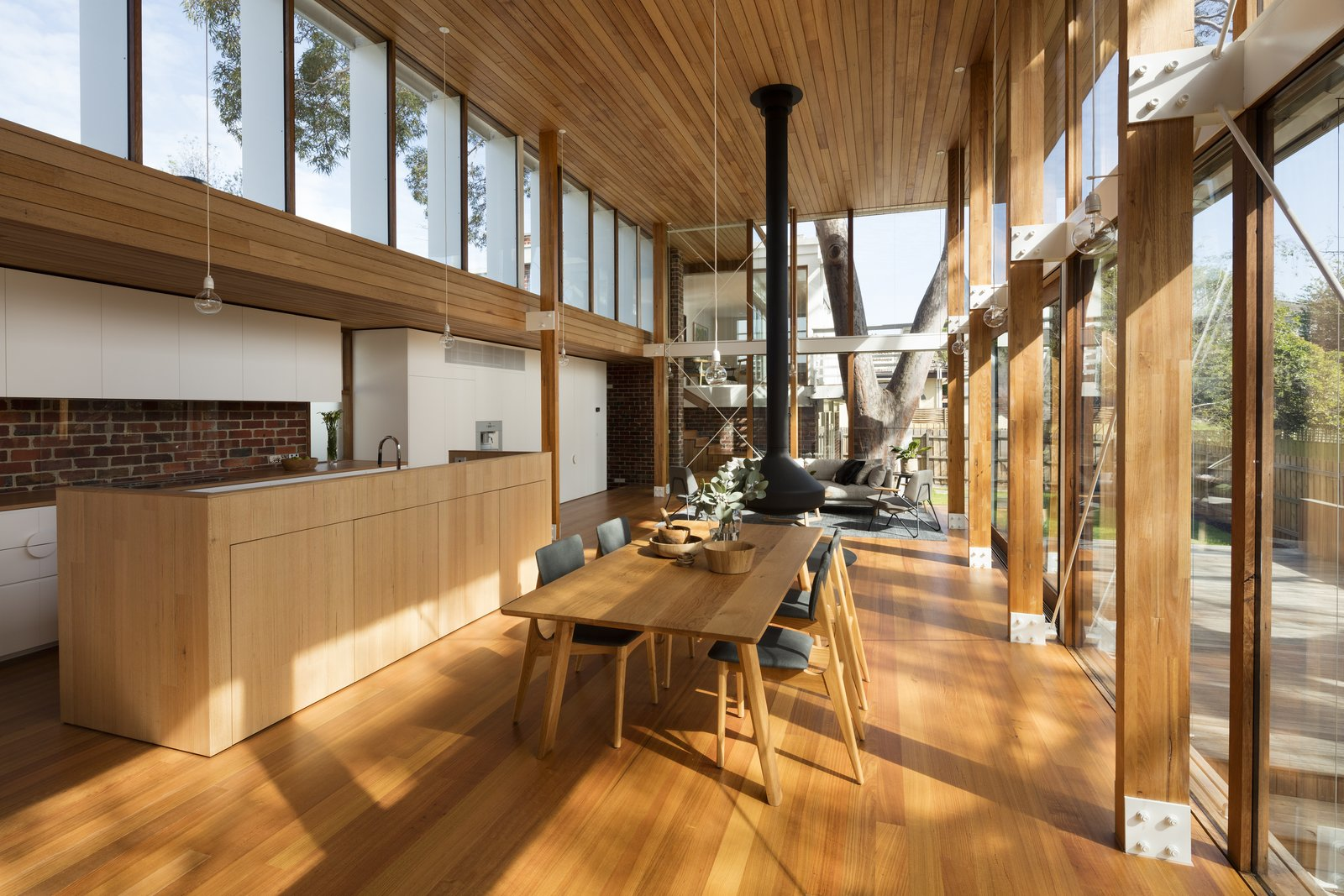 The interiors were reworked into a split-level open-plan living space that evokes a feeling of being standing on top of the fence, and being totally connected with the park.