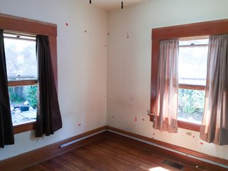 Before the renovation, the master bedroom suffered from termite-damaged floors.