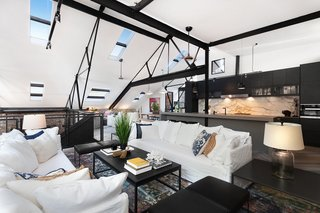 The living area on the upper level leads out to a rooftop terrace.