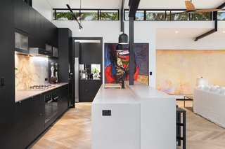 The kitchen includes a generous butler's pantry with Libeherr refrigerators.