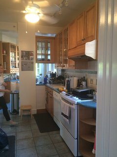 They replaced the wall between the dining room and the kitchen with a recessed beam to create a more open floor plan.
