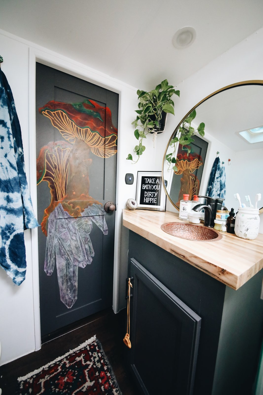 For the bathroom, they used the leftover butcherblock from the kitchen, and a hammered copper sink that they found via eBay.