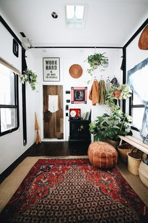 "Autumn decorated the toy hauler with Persian rugs, which she bought on eBay for $99 each. She also incorporated poufs and woven flat baskets that she ""borrowed"" from her mother."
