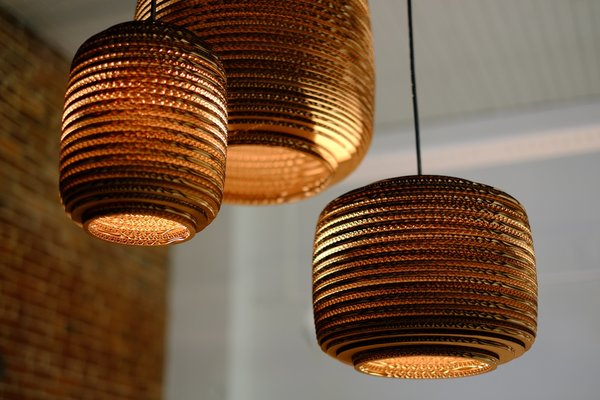 Made of recycled corrugated cardboard, the Scraplight series of pendent lamps by Seattle design studio Graypants Inc. can be used with low-energy 12.5-watt Philips LED bulb for lighting that is both green and efficient.