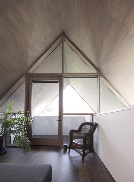 The window system, which was built on site, repeats the simple vernacular geometry of the exterior.