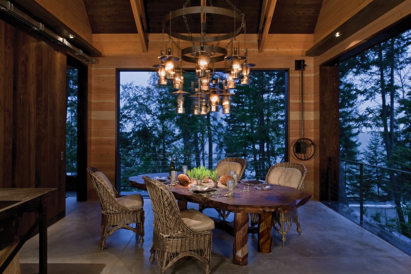 Dining Room, Concrete Floor, Chair, Pendant Lighting, Table, and Recessed Lighting The Lake House is equipped with its own living room, kitchen, and amenities.  Photo 8 of 14 in Stacked-Wood Walls Tie This Eco-Friendly Camp to the Montana Landscape