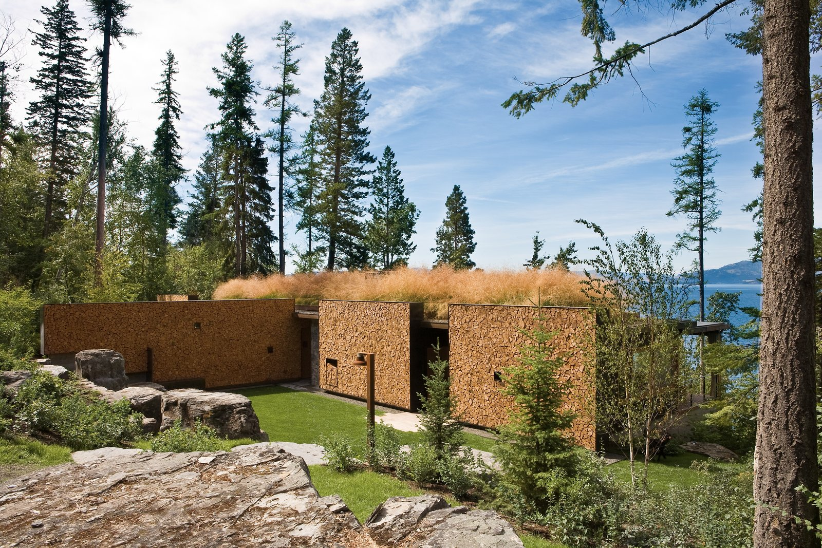Stacked-Wood Walls Tie This Eco-Friendly Camp to the Montana Landscape