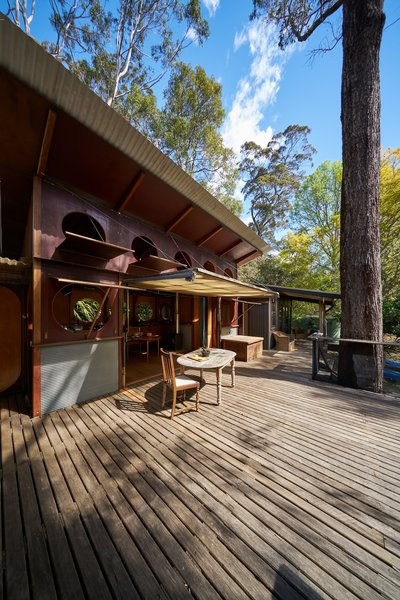 The long decking boards extend out into the Pittwater bush.