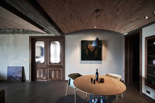 Polished concrete provides a surprising contrast to the raw surfaces of the ceiling.