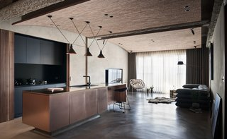 The open-plan kitchen flows seamlessly into the living area.