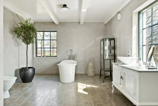 The interiors consist of a large living room and kitchen, along with seven other rooms, four of which are designated as bedrooms. Here is a closer look at one of the bathrooms.