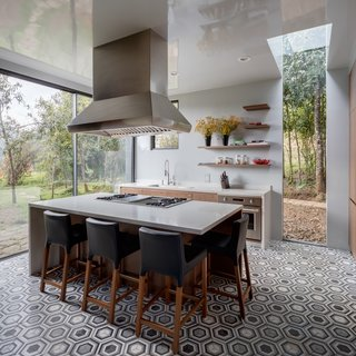 Black-and-white walls, polished basalt floors, and oak ceilings give the interiors a simple, pared-back aesthetic that allow the nature outdoors to take center stage.