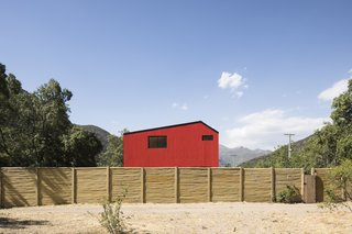 Assadi says that the color red is commonly used for homes in this part of Chile.