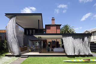 A Steel Mesh Curtain Wraps Around This Renovated Australian Home
