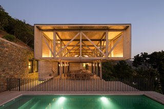 On the lower level is a fully-glazed living and dining space that leads to an outdoor pool and terrace area.