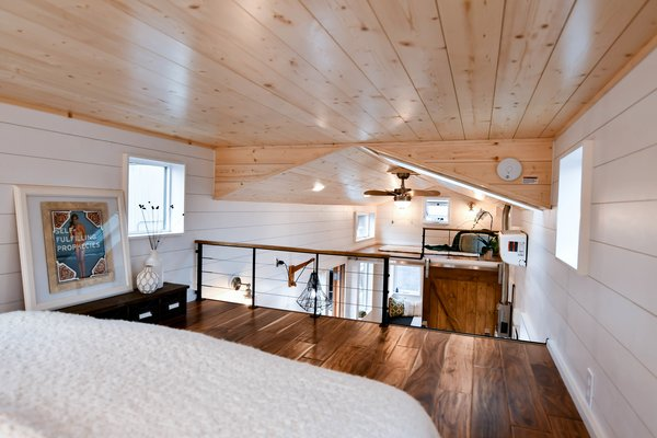 The couple added solid surfaces, cable railings, kitchen and bathroom tiling, open cedar siding, a residential mini-split heater, a Dickenson propane heater, and a six-panel solar system.