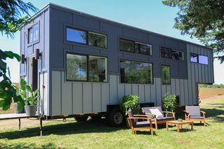 Built on a gooseneck trailer, with a facade of 100-percent recycled steel and flat-pack siding, this ultra-modern tiny home is perfect for frequent traveling.