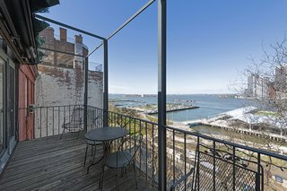 The three-bedroom, two-bathroom flat has several outdoor terraces that look out to panoramic views of Manhattan, the Brooklyn Bridge Park, and the Statue of Liberty.